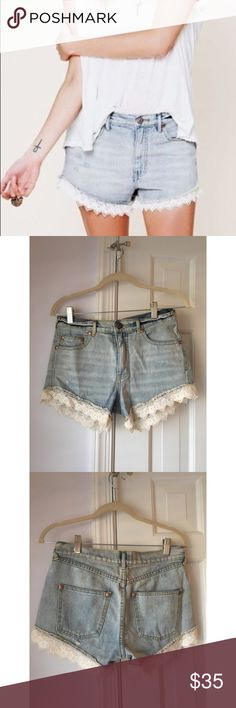 Free People White Embroidered Trim Jean Shorts Light wash denim shorts with white lace/embroidered trim on the bottom. In great condition. Semi stretchy and very soft denim. Free People Shorts Jean Shorts