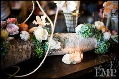 cotton & flowers on a log