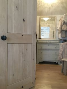 This is my closet. Our European (French and Swedish) style modern farmhouse master bedroom makeover entailed new white oak hardwood flooring, rustic knotty alder doors with oil rubbed bronze door hardware, and a Stikwood reclaimed wood plank (like shiplap) statement wall. It's feminine, romantic, shabby chic, and country lovely.