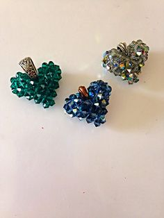 "In this instructional video see how I use Swarovski crystal beads to make a 3-d ""puffed"" heart."