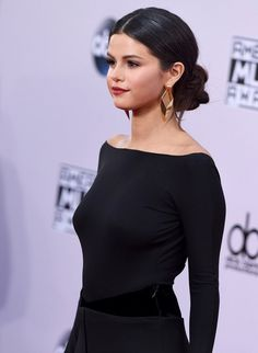 Selena Gomez in low bun Chignon updo Hairstyle at The American Music Awards 2014 AMAs.