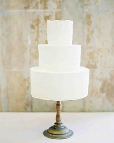 Trending Now: Deckle-Edged Wedding Cakes   Martha Stewart Weddings - Lily Cupcake created this ultra-classic deckle-edge confection, proving that sometimes the only accent you need for an all-white dessert is a little bit of rough frosting.
