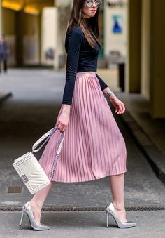 Pink Pleated tulle tea-length Skirt, silver stilettos & eyeshades, navy top, chestlength chestnut hair, quilted white clutch