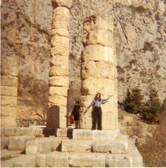 Angelique Rockas in front of doric pillars   located in the ancient theatre of Delphi