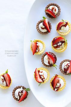 Strawberry Cheesecake Tartlets from @Bakers Royale | Naomi! Get the full recipe on our Delish Dish blog: http://www.bhg.com/blogs/delish-dish/2014/03/17/strawberry-cheesecake-tartlets/