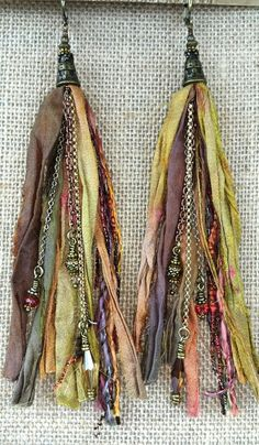 These tassels are created with reclaimed, silk sari ribbon in gorgeous, sunset colors. Warm and rich, the color mix of these earrings are the perfect, sun-kissed neutral. Created with chain in mixed m Ribbon Jewelry, Tassel Jewelry, Textile Jewelry, Fabric Jewelry, Leather Jewelry, Jewelry Crafts, Jewelry Art, Beaded Jewelry, Jewelry Design