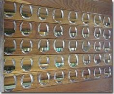 Horseshoe wall of fame. Great idea for the barn! Take a horseshoe from each horse you've owned and put them on the wall  equine stable  #equestrian