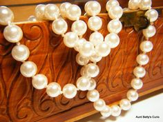 """Spectacular Vintage 26"""" strand of 7.5-8.0mm lab created pearls.  Knotted between each pearl.  Typical Gold styled pearl clasp. by AuntBettysCurio on Etsy"""