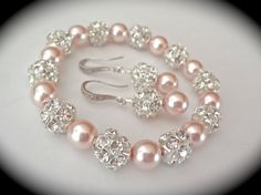 Natasha. Stunning, love the rose coloured pearls.                                                                                                                                                                                 More