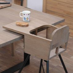 High chair. The tray design that overhangs the table is what I like.