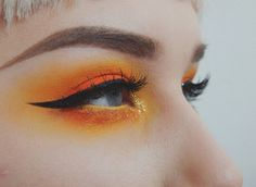 Orange eye makeup - love these colours x