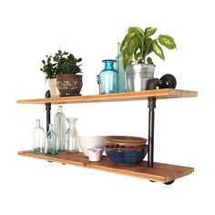 Reclaimed wood and steel piping give this two-tiered shelf a look that's one of a kind. Handmade from parts salvaged across the East Coast, it's a fun and fashionable way to display your favorite title...  Find the Pipeline Double Shelf, as seen in the Our Favorite Industrial Designs Collection at http://dotandbo.com/collections/our-favorite-industrial-designs?utm_source=pinterest&utm_medium=organic&db_sku=RCP0001