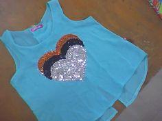 ropa de mujer blusa de dama manga sisa amplia, cruzado en posterior y cozazon el lentejuelas elaborada en tejido plano