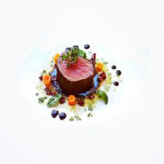 Perfect piece of meat! garnished with green olives, mallorquin sun dried tomatoes, sauteed pumkin, thyme,basil grated parmesan and demi glace   by uwe spätlich