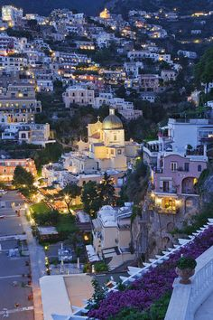 Positano, Italy at dusk. A city not to be missed on a trip to Tuscany. ASPEN CREEK TRAVEL - karen@aspencreektravel.com