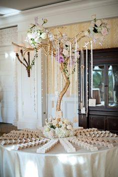 Gold Tree Escort Card Display    Photography: Kristen Weaver Photography   Read More:  http://www.insideweddings.com/weddings/gold-white-wedding-with-brazilian-indian-flair-in-orlando-fl/647/