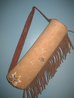 """Native American-Inspired Quiver      I know I said I'd do a holster tute, but my six-year old has been patiently waiting for a quiver for his Native American costume, and well, the one-year old really doesn't care about his holster, so...      Native American-Inspired Quiver!      Here is how I made it...    Materials:  -two contrasting suede-like fabrics  -fleece  -plastic canvas  -fringe      1. Cut the plastic canvas down to approximately 16"""" by 12"""".    2. Cut one of fleece the same size…"""