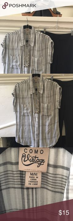 Come Vintage Super Soft Short Sleeve Button Down Black and white plaid on the inside, stripes on the outside… This super comfortable shirt can be easily dressed up or down white jeans or Jean shorts black pants white skirt you name it it will match with the shirt that will help keep you comfy cool and in style all summer long como vintage Tops