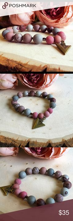 Beautiful Stretch Bracelet Gorgeous handmade stretch bracelet. Matte beaded and cute arrowhead charm. Great for layering or wearing alone. Handmade Jewelry Bracelets
