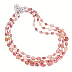 CONCH PEARL AND DIAMOND NECKLACE The triple-stranded necklace composed of ninety-four graduated conch pearls measuring approximately 13.91 x...