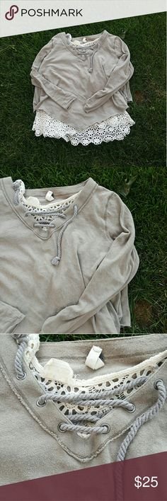 Free people lace up top Free people we the free lace up top size xs. Long sleeve, light weight material can be layered. Its a top that hits right above the hips so i layered it with the tank seen in the pics. Free People Tops Tees - Long Sleeve
