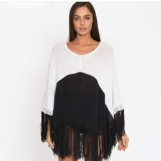 Black and white poncho. One size. Fits shorter than shown in photo.  All sales final Aila blue Sweaters Shrugs & Ponchos