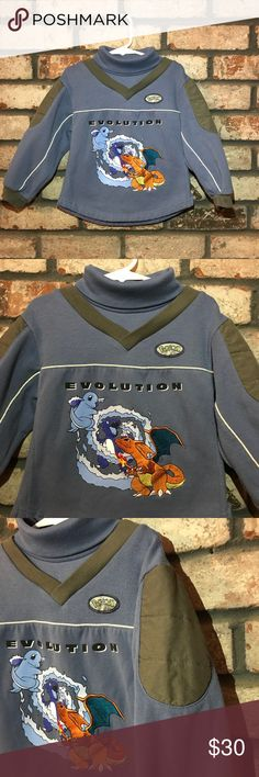 """Vintage Pokémon youth sweater Pokémon Evolution youth turtleneck fleece inlined sweater  Brand: Pokémon (Nintendo) Size: 5 youth  Color: light blue Materials: 65% polyester 35% cotton  This vintage turtleneck sweater will keep your child warm. It is fleece lined and features light padding on the outer arm. It reads: """"Evolution"""" and features the evolving of Charmander. It has the Pokémon label on the front as well. Pristine condition. NO fading. Detailed pictures, please view. Pokemon Shirts…"""