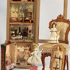 Tiny dolls and furniture for a Dollhouse child to play with.