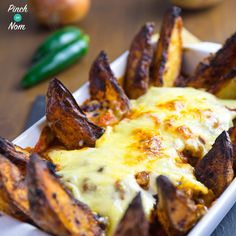 After a cold evening spent watching my daughter at football practise, I really fancied some comfort food. These Syn Free Chilli Cheesy Nachos were perfect