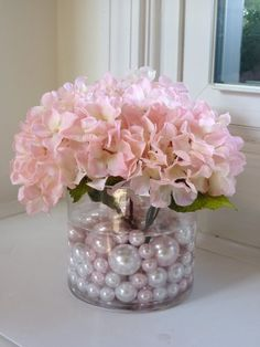 use several of these down the center of a table - like the pearls...and minus the flowers...