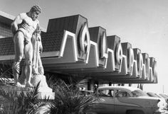 "The statue and neon sign in front of the Aladdin (Las Vegas), 1966. From the UNLV Libraries ""Dreaming the Skyline: Resort Architecture and the New Urban Landscape"" digital collection."