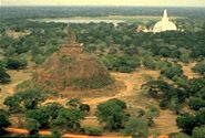 "SRI LANKA. Sacred City of Anuradhapura...""established around a cutting from the 'tree of enlightenment', the Buddha's fig tree, brought there in the 3rd century B.B. by Sanghamitta, the founder of an order of Buddhist nuns."" The site was inaccessible in dense jungle, but can now be visited."