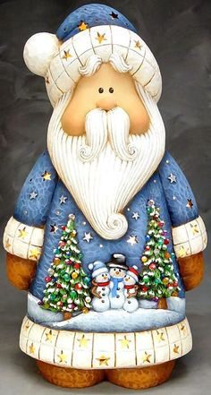 A modern day Santa in blue!!! Bebe'!!! His outfit decorated with holiday scenes!!!