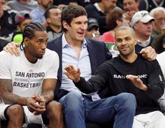 San Antonio Spurs' Kawhi Leonard (from left), Boban Marjanovic, and Tony Parker joke while on the bench during second half action against the Utah Jazz Monday Dec. 14, 2015 at the AT&T Center. The Spurs won 118-81. Photo: Edward A. Ornelas, Staff / San Antonio Express-News / © 2015 San Antonio Express-News