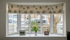 Roman Blinds can be the perfect solution to dress a bay window without blocking the window sill. Bespoke Blinds by SauPing
