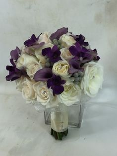 Bridal bouquet with roses, calla lilies and orchids
