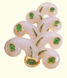 Brooch of chalcedony, yellow gold, with calibre-cut  emeralds  and cabochon-cut emeralds, via Diamonds and Rhubarb