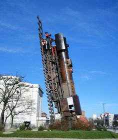 The Train to Heaven is a monument depicting an old, real steam locomotive standing upright and pointing towards the sky, located at Strzegomski Square in Wroclaw, Poland.  The 65-year old engine was procured from a museum and erected here in 2010 by artist Andrzej Jarodzki.