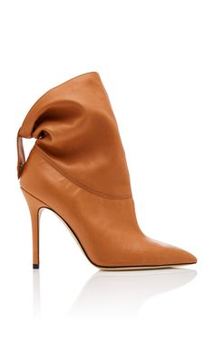 This **Brian Atwood** bootie is rendered in nappa leather and features a stiletto heel and strap detail.