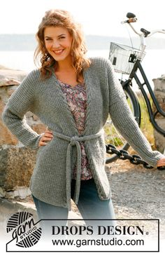 "Knitted long DROPS jacket or vest with textured pattern, cable edge and belt in ""Karisma"". Size: S to XXXL. ~ DROPS Design"
