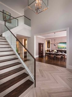 Foyer flooring ideas staircase transitional with dark wood staircase glass stair railing herringbone floor herringbone wood floor Modern Stair Railing, Stair Railing Design, Staircase Railings, Modern Stairs, Railing Ideas, Staircases, Modern Hall, Banisters, Tile Stairs