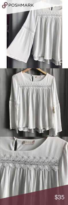 White bell sleeve top NWT Altar'd State whit long bell sleeve  top with crochet detailing at top and sleeves. Size small Altar'd State Tops Blouses