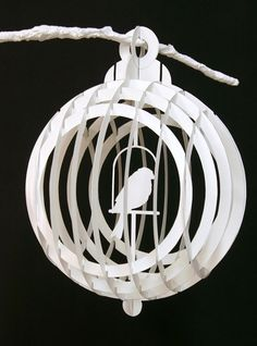 "Collapsible paper birdcages, built from sliceforms. Cut and assembled by hand.  Inspired by the paper creations of Masahiro Chatani    2011  Various sizes, up to 12""  Unique set"