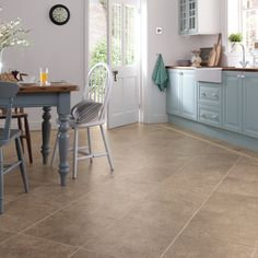 Santi Limestone brings a rich, earthy grey-brown hue to the gentle mottled pattern and softly pitted surface texture of our Da Vinci limestone collection. For a really authentic finishing touch, browse our range of feature strips to find the perfect companion to these attractive limestone effect tiles.  Order your #free sample today! Karndean Vinyl Flooring, Vinyl Tile Flooring, Limestone Flooring, Luxury Vinyl Flooring, Kitchen Flooring, Newcastle, Home Design, Bedroom Wood Floor, Tiles Uk