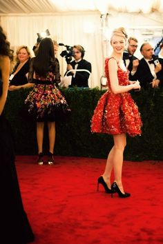 I love this photo of Emma Stone on the red carpet in a red dress. Adorable.