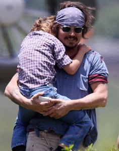 One of the reasons I adore Johnny so much, is how amazing he is as a father. He loves his children, Lily-Rose and Jack dearly, and it just warms my heart whenever I see a picture of him hugging them, holding their hand or just watching them with that adorable, loving smile of his.   -S♥