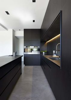 An ultra modern dark kitchen. www.chossechi.com