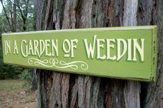 Garden Sign.  In a Garden of Weedin