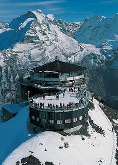 Piz Gloria / Schilthorn summit, Switzerland. This is the only revolving restaurant I'll ever admit visiting, and the only time I'll ever link to a James Bond website... The cable car to the top is very expensive, and the best discount is with a SwissRailPass (rather than a EurRail pass). The views are spectacular; check the webcam online to make sure the weather up top is clear before you go. The Bond movie is a must-see - vacation homework!