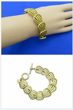 Golden cut out shells are layered in this nautically attractive toggle bracelet from Anne Klein. #stuff4uand4u